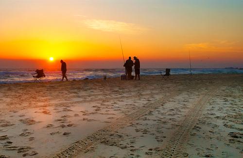 Fishermen setting up at daybreak on Surf Beach, Narooma. Australia